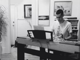 John on piano